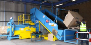 Recycling waste baler load